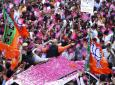 India's ruling Bharatiya Janata Party (BJP) President Amit Shah is showered with flower petals as he arrives at the party office in new Delhi, India, Thursday, May 23, 2019. Indian Prime Minister Narendra Modi's party claimed it had won reelection with a commanding lead in Thursday's vote count. (AP Photo/Manish Swarup)