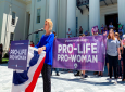 In this Wednesday, May 22, 2019, file photo, Beck Gerritson, president of Eagle Forum of Alabama, speaks at an anti-abortion rally outside the Capitol in Montgomery, Ala. Even as the anti-abortion movement celebrates passage of sweeping bans in several states, a rift is widening between activists who oppose exceptions for rape and incest, and other abortion opponents, including many Republican politicians, who support those exceptions. (AP Photo/Kim Chandler, File)