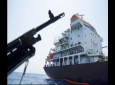 Sailors stand on deck above a hole the U.S. Navy says was made by a limpet mine on the damaged Panama-flagged, Japanese owned oil tanker Kokuka Courageous, anchored off Fujairah, United Arab Emirates, during a trip organized by the Navy for journalists, Wednesday, June 19, 2019.