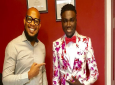 Designer Ecliff Elie with one of the students he outfitted for grad.
