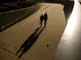 FILE - In this Thursday, Sept. 27, 2018 file photo, an elderly couple walks past the Berlaymont building, the European Commission headquarters, in Brussels. (AP Photo/Francisco Seco, File)