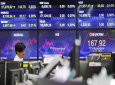 A currency trader watches monitors at the foreign exchange dealing room of the KEB Hana Bank headquarters in Seoul, South Korea, Tuesday, Sept. 17, 2019. Shares were mostly lower in Asia on Tuesday after an attack on Saudi Arabia's biggest oil processing plant caused crude prices to soar, prompting selling of airlines and other fuel-dependent industries. (AP Photo/Ahn Young-joon)