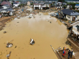 Residential area is flooded after an embankment of the Chikuma River broke due to Typhoon Hagibis, in Nagano, central Japan Tuesday, Oct. 15, 2019. Hagibis hit Japan's main island on Saturday, unleashing strong winds and dumping historic rainfall that caused more than 200 rivers in central and northern Japan to overflow, leaving thousands of homes flooded, damaged or without power. (Kyodo News via AP)