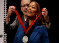 Music artist and actress Queen Latifah receives the WEB Dubois Medal for her contributions to black history and culture from Glenn H. Hutchins during ceremonies at Harvard University, October 22, 2019, in Cambridge, Mass. (AP Photo/Elise Amendola)