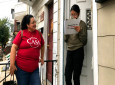 Mirna Orellana, left, a community organiser from the non-profit group We Are Casa, helps Karyme Navarro, right, fill out a voter registration form in York, Pa., on September 30, 2019. (AP Photo/Will Weissert)