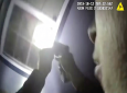 In this Saturday, Oct. 12, 2019, image made from a body camera video released by the Fort Worth Police Department an officer shines a flashlight into a window in Fort Worth, Texas.