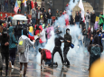 Anti-government protesters clash with the police during a nationwide strike, at Bolivar square in downtown Bogota, Colombia, Thursday, Nov. 21, 2019. Colombia's main union groups and student activists called for a strike to protest the economic policies of Colombian President Ivan Duque government and a long list of grievances. (AP Photo/Fernando Vergara)