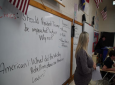 Civics teacher Aedrin Albright stands before her class at Chatham Central High School in Bear Creek, N.C., November 5, 2019. The class is debating whether President Trump should be impeached. (AP Photo/Allen G. Breed)