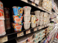 This July 11, 2018, file photo shows yogurt on display at a grocery store in River Ridge, La. Despite shelves full of new varieties, from Icelandic to Australian to coconut-based, U.S. yogurt sales are in a multiyear slump. Yogurt companies are confident that more new products can boost sales. But some analysts are skeptical, saying larger trends - like growing sales of breakfast protein bars - will be hard to turn around. (AP Photo/Gerald Herbert, File-