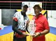 Top Gun 2019 Overall Champion Corporal Marlon Moses collects his trophy from Trinidad Rifle Association Executive member Mr. Louis Tanwing