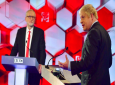 Opposition Labour Party leader Jeremy Corbyn, left, and Britain's Prime Minister Boris Johnson during a head-to-head live Election Debate at the BBC TV studios in Maidstone, England on December 6, as the UK prepares for general elections on December 12. The moderator is TV presenter Nick Robinson, right. ( Jeff Overs/BBC via AP)