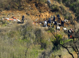 Investigators work the scene of a helicopter crash that killed former NBA basketball player Kobe Bryant, his 13-year-old daughter, Gianna, and several others Monday, January 27, 2020, in Calabasas, Calif. (AP Photo/Mark J. Terrill)