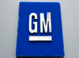 FILE - This January 27, 2020, file photo shows a General Motors logo at the General Motors Detroit-Hamtramck Assembly plant in Hamtramck, Michigan. (AP Photo/Paul Sancya, File)