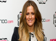 FILE - In this file photo dated Thursday, November 3, 2011, British TV personality Caroline Flack arrives for the Cosmopolitan Ultimate Women of the Year Awards in London. (AP Photo/Jonathan Short, FILE)