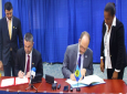 UAE Assistant Minister Omar Saif Ghobash (left) and CARICOM Secretary-General Ambassador Irwin LaRocque and sign the MOU. Photo: CARICOM Secretariat