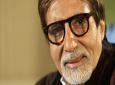 FILE - In this Nov. 10, 2009 file photo, Bollywood legend Amitabh Bachchan speaks during an interview in London. Bachchan has tested positive for COVID-19 and hospitalised in Mumbai, India's financial and entertainment capital. In a tweet on Saturday, July 11, 2020, Bachchan, 77, said his family and staff have also undergone tests and results are awaited. (AP Photo/Alastair Grant, File)