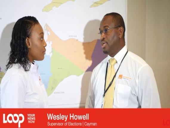 Loop Cayman Reporter Denieca Brown speaking with Supervisor of Elections Wesley Howell