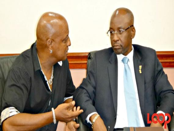 President of the Barbados Association of Masqueraders (BAM), Chetwyn Stewart (left) and Culture Minister, Stephen Lashley.