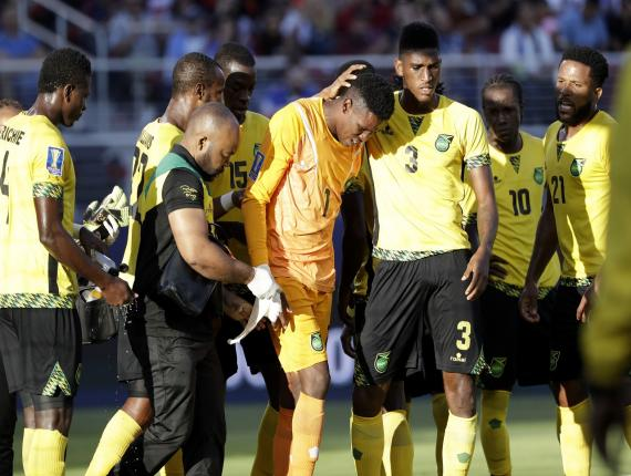 Jamaica goalkeeper Andre Blake, center, walks off the field after being injured during the first half of the Gold Cup final  against the United States in Santa Clara, Calif., on Wednesday night.