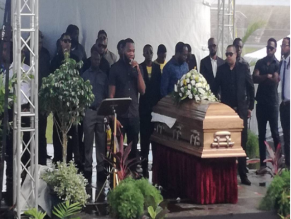 Devon Matthews' colleagues from Red 96.7 united on stage at the funeral of their friend.