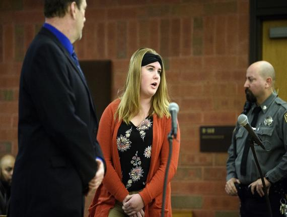 Brianna Brochu, accused of contaminating her black roommate's belongings at the University of Hartford, addresses the court during a hearing, Tuesday. (PHOTO: AP)