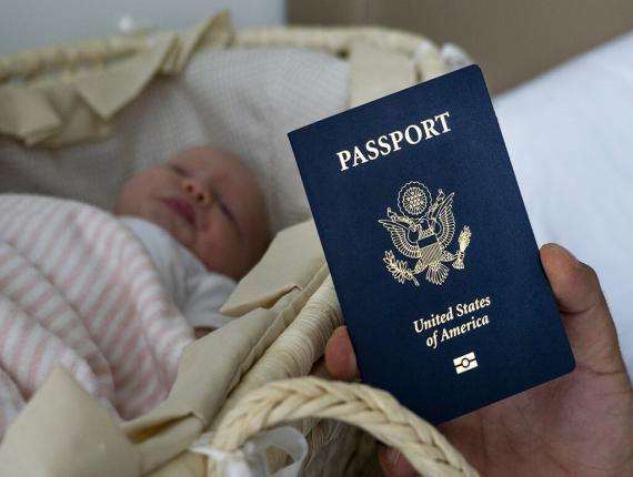 In this photo taken on January 24, 2019, Denis Wolok, the father of 1-month-old Eva's father, shows the child's U.S. passport during an interview with The Associated Press in Hollywood, Fla. (AP Photo)
