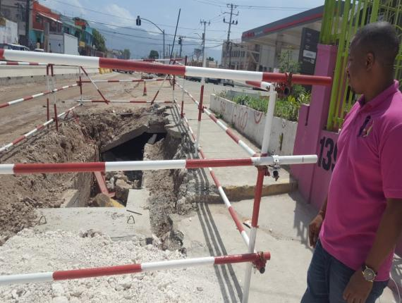 Businessman Juma Levy lamenting the circumstances he, like other business operators along the Hagley Park Road strip in St Andrew, has had to endure for many months amid major road improvement works in the area. (Photos: Marlon Reid)