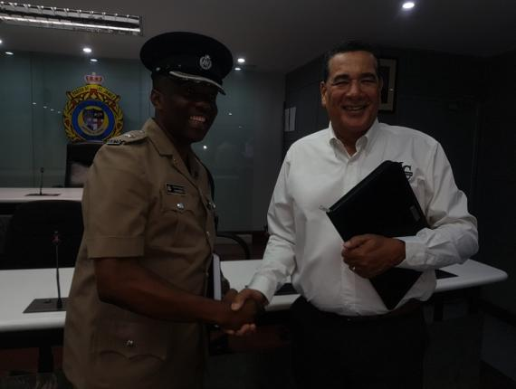 Superintendent Vernon Ellis (left), commanding officer of the St James Police Division, greets Montego Bay Mayor, Homer Davis, at a meeting last Friday ahead of Monday's multi-agency clampdown on public disorder in Montego Bay, St James.