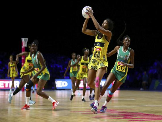 Jamaica's Rebekah Robinson looks for a pass during their Netball World Cup match against Zimbabwe at the M&S Bank Arena, Liverpool, England, Friday, July 19, 2019. (Nigel French/PA via AP).