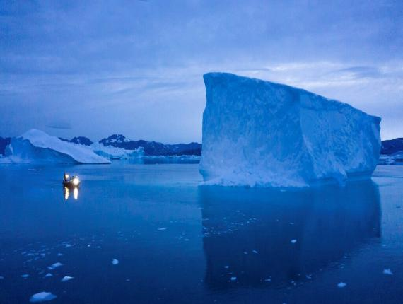 "In this Aug. 15, 2019, photo, a boat navigates at night next to icebergs in eastern Greenland. U.S. President Trump announced his decision to postpone a visit to Denmark by tweet on Tuesday Aug. 20, 2019, after Danish Prime Minister Mette Frederiksen dismissed the notion of selling Greenland to the U.S. as ""an absurd discussion."" (AP Photo/Felipe Dana)"