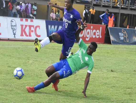 Kingston College's (KC) Sajar Blair is challenged by a defender from Vauxhall during their second round first-leg match of the 2019 ISSA/Digicel Manning Cup football competition at the Stadium East field on Wednesday, October 23, 2019.  KC won 3-1. (PHOTOS: Marlon Reid).