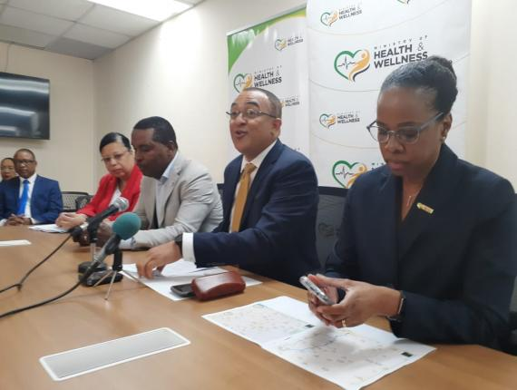 Health Minister Dr Christopher Tufton (second right) addresses journalists at an emergency press conference in Kingston on Tuesday. (Photo: Marlon Reid)