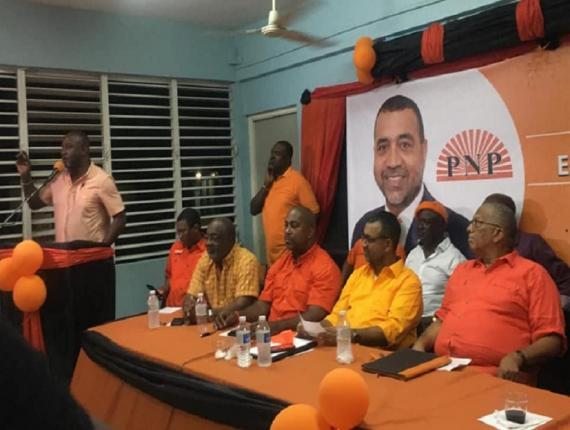 North West St Ann MP, the PNP's Dr Dayton Campbell (left) addressing Comrades at a party meeting in East Central St Catherine to introduce Dr Winston De La Haye (second right) as the party's caretaker in the constituency. Other senior PNP members including party president Dr Peter Phillips (third right) share in the occasion.