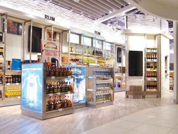 Duty-free liquor store joint venture between BlackBeard's and Jacques Scott in the Owen Roberts International Airport departures lounge. Image Source: Camanabay.com
