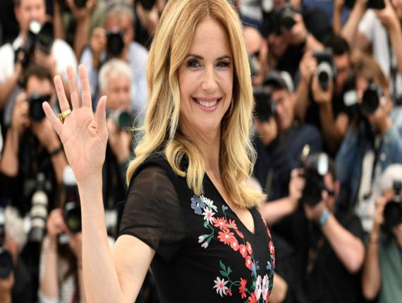 """In this May 15, 2018, file photo, actress Kelly Preston poses for photographers during a photo call for the film 'Gotti' at the 71st international film festival, Cannes, southern France. Actress Kelly Preston, whose credits included the films """"Twins"""" and """"Jerry Maguire,"""" died Sunday, July 12, 2020, her husband John Travolta said. She was 57.(Photo by Arthur Mola/Invision/AP, File)"""