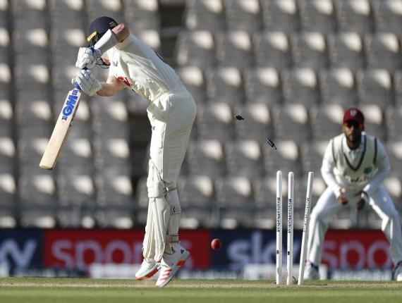 England's Ollie Pope is bowled by West Indies' Shannon Gabriel during the fourth day of the first cricket Test match, at the Ageas Bowl in Southampton, England, Saturday, July 11, 2020. (Adrian Dennis/Pool via AP).