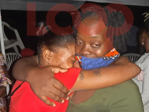 Demarco's mother, Tricia Gibbs (left) being comforted by Keisha Thomas, (right) the mother of the 11-year-old who was bullied online recently.