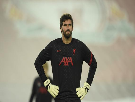 Liverpool's goalkeeper Alisson takes part in the warm up ahead of the English Premier League football match against Sheffield United at Anfield in Liverpool, England, Saturday, Oct. 24, 2020. (Stu Forster/Pool via AP).