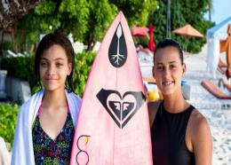Champion surfer and Suzuki Caribbean ambassador, Chelsea Tuach, presents Keana Banfield with her very own surfboard.