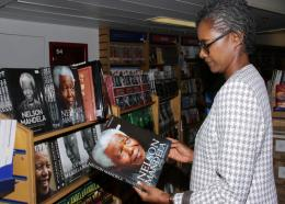 A visitor looks at a book on late South African anti-apartheid revolutionary and former president, Nelson Mandela, at the Logos Hope book fair in Kingston.