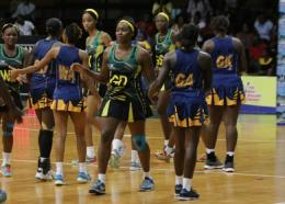 Barbados and Jamaica players on court at the National Arena in Jamaica.