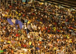 Jamaicans gather at the National Stadium in Kingston.