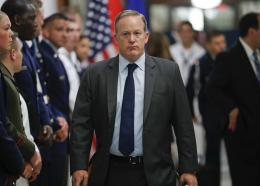White House press secretary Sean Spicer walks down the hallway during President Donald Trump's visit to the Pentagon, Thursday, July 20, 2017. White House Press Secretary Sean Spicer has resigned over hiring of new communications aide.