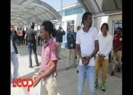 Alleged lotto scammers at NMIA before being extradited in April.