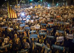 Holding candles and independence flags, people march on one of the city's main avenues to protest against the National Court's decision to imprison civil society leaders without bail, in Barcelona, Spain, Tuesday, Oct. 17, 2017. Spain's top court also ruled Tuesday that a recent independence referendum in Catalonia was unconstitutional, a day after a Madrid judge provisionally jailed two Catalan independence leaders, Jordi Sanchez and Jordi Cuixart, in a sedition probe.(AP Photo/Manu Fernandez)