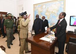Zimbabwean President, Robert Mugabe, right, meets with Defence Forces Generals at State House, in Harare, Sunday, Nov, 19, 2017. Members of the ZANU PF Central committee fired Mugabe as chief and replaced him with dismissed deputy President, Emmerson Mnangagwa on Sunday. (AP Photo)