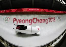 Nadezhda Sergeeva driving the two-woman bobsleigh for Olympic Athletes from Russia.