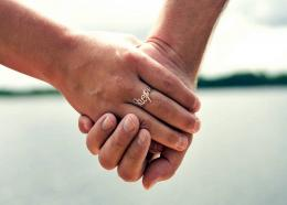 (Image: File picture of two people holdings hands by Yoel Ben-Avraham)