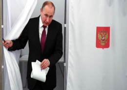 Russian President and Presidential candidate Vladimir Putin exits a polling booth as he prepares to cast his ballot during Russia's presidential election in Moscow, Russia, Sunday, March 18, 2018. Putin's victory in Russia's presidential election Sunday isn't in doubt. The only real question is whether voters will turn out in big enough numbers to hand him a convincing mandate for his fourth term — and many Russian workers are facing intense pressure to do so. (Yuri Kadobnov/Pool Photo via AP)