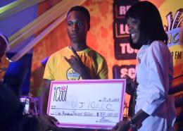 Jose Marti Technical's Pete Murphy, aka DJ Igloo, collects the winner's cheque after the finals of the Suncity 104.9 FM High School Disc Jock competition. (PHOTOS: Marlon Reid)